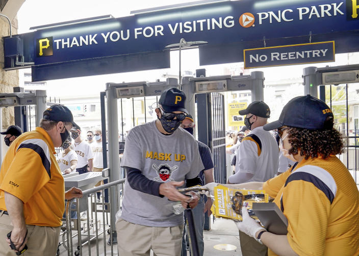 Fans enter PNC Park before the Pittsburgh Pirates take on the Chicago Cubs in the Pirates home opening baseball game at PNC Park in Pittsburgh, Thursday, April 8, 2021. (Matt Freed/Pittsburgh Post-Gazette via AP)