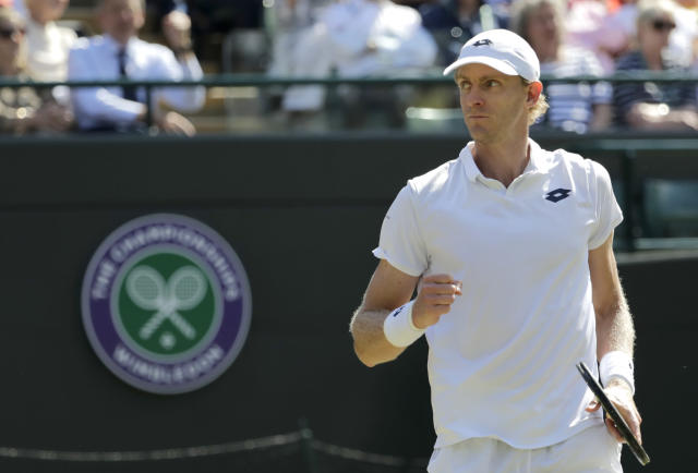 Kevin Anderson of South Africa celebrates breaking serve in his men's quarterfinals match against Switzerland's Roger Federer, at the Wimbledon Tennis Championships, in London, Wednesday July 11, 2018. (AP Photo/Ben Curtis)