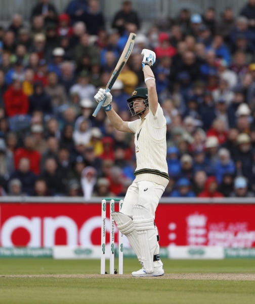 Australia's Steve Smith reacts after a delivery during day one of the fourth Ashes Test cricket match between England and Australia at Old Trafford in Manchester, England, Wednesday, Sept. 4, 2019. (AP Photo/Rui Vieira)