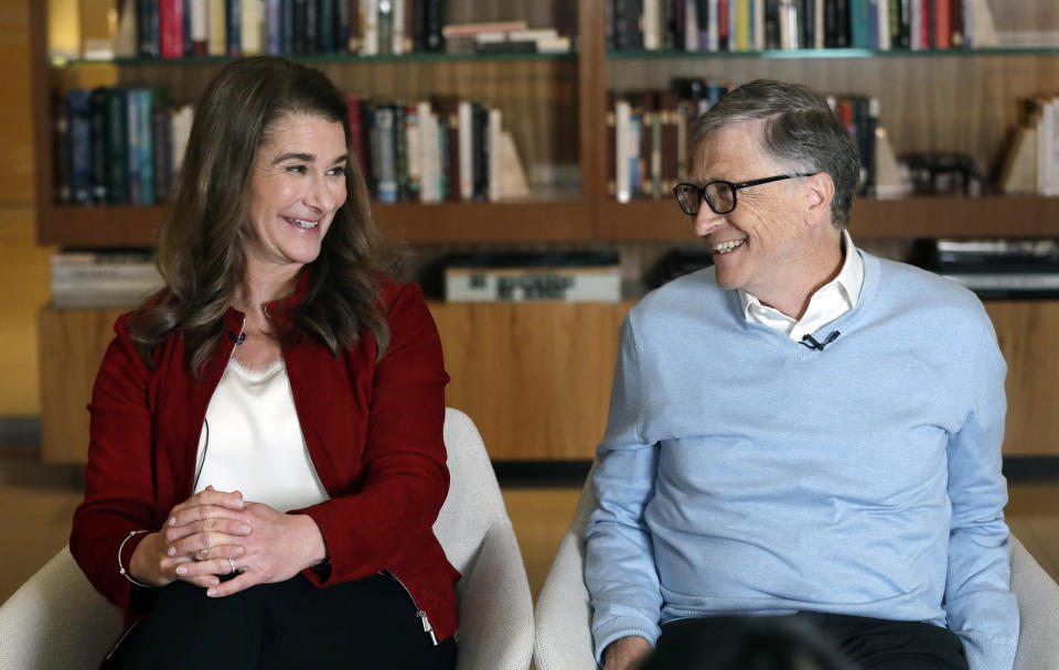 In this Feb. 1, 2019, Bill and Melinda Gates look toward each other and smile while being interviewed in Kirkland, Wash. The couple, whose foundation has the largest endowment in the world, are pushing back against a new wave of criticism about whether billionaire philanthropy is a force for good. They said they're not fazed by recent blowback against wealthy giving, including viral moments at the World Economic Forum and the shifting political conversation about taxes and socialism. (AP Photo/Elaine Thompson)