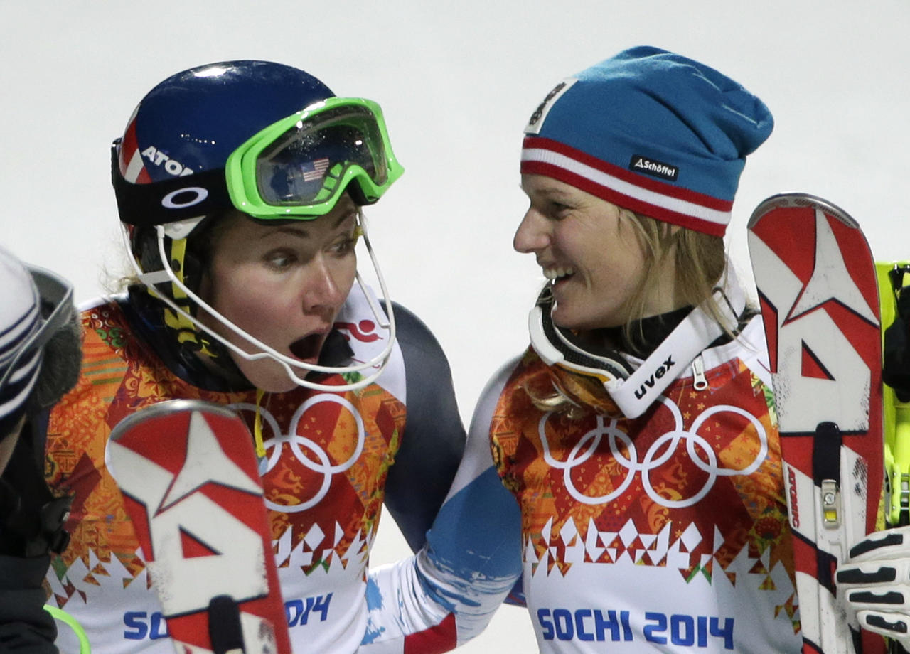 United States' Mikaela Shiffrin, left, and Austria's Marlies Schild celebrate winning gold and silver in the women's slalom at the Sochi 2014 Winter Olympics, Friday, Feb. 21, 2014, in Krasnaya Polyana, Russia. (AP Photo/Gero Breloer)