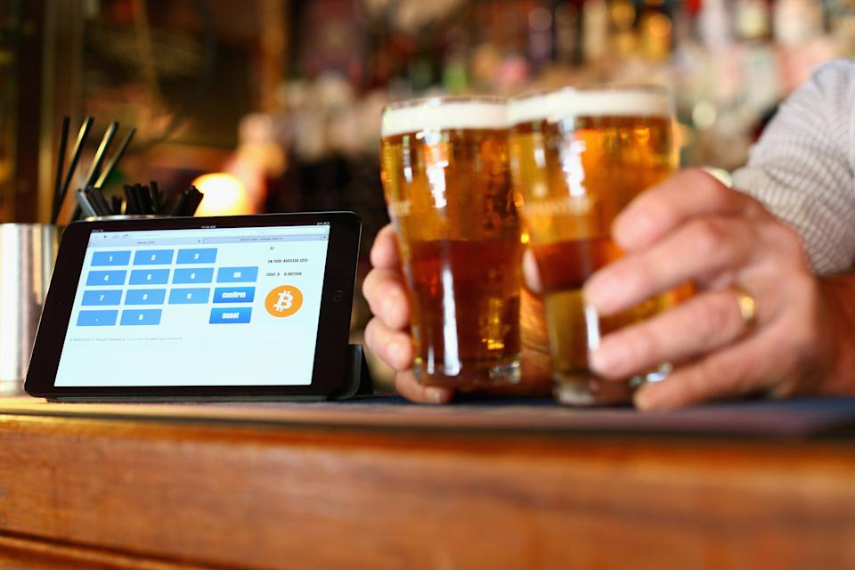 SYDNEY, AUSTRALIA - SEPTEMBER 19:  In this photo illustration, a terminal to accept payments using bitcoins is displayed on the bar at the Old Fitzroy pub on September 19, 2013 in Sydney, Australia.  (Photo by Cameron Spencer/Getty Images)
