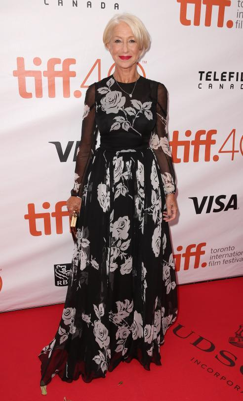 "<p>Helen Mirren attended the ""Eye In The Sky"" premiere during the 2015 Toronto International Film Festival in a black and white Valentino gown with flowers that was fun and fresh on the 70 year old actress.</p>"