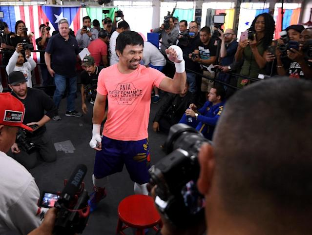 Manny Pacquiao jokes with reporters ahead of his January 19 fight with Adrien Broner in Las Vegas (AFP Photo/Harry How)