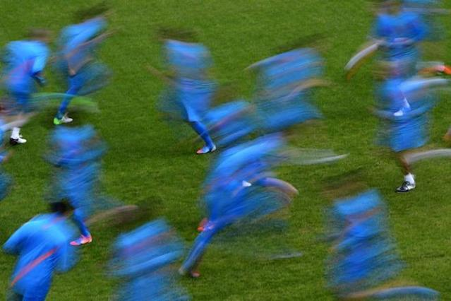 TOPSHOTS Dutch players are seen with a slow speed exposure on May 18, 2012 in Lausanne during a training session ahead of the Euro 2012. The Netherlands national football has a training camp in Switzerland. TOPSHOTS/AFP PHOTO / FABRICE COFFRINIFABRICE COFFRINI/AFP/GettyImages