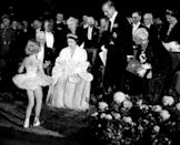 <p>Queen Elizabeth receives a curtsy from a young dancer from the Winnipeg Ballet during her royal tour of Canada in 1951.</p>