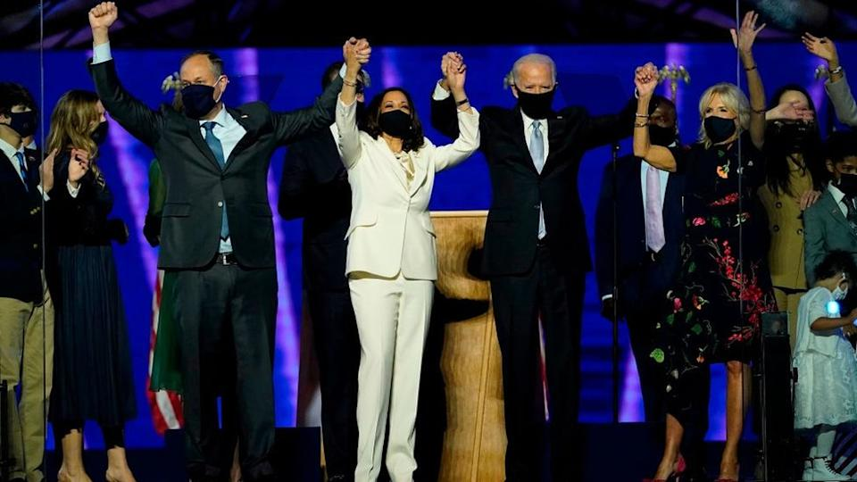 President-elect Joe Biden and Vice President-elect Kamala Harris, stand with their spouses, Dr. Jill Biden and Douglas Emhoff, after addressing the nation from the Chase Center November 07, 2020 in Wilmington, Delaware