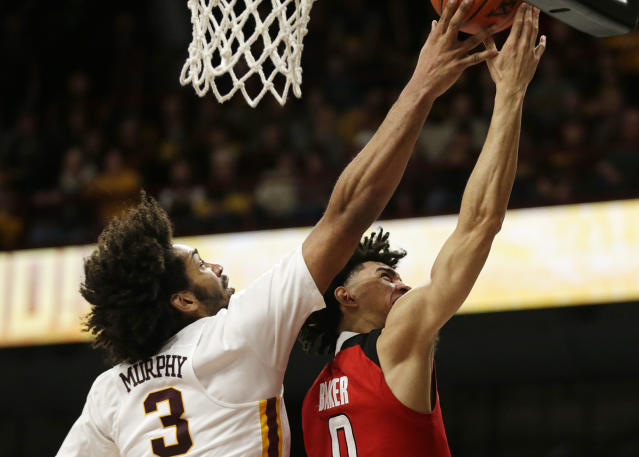 Rutgers guard Geo Baker (0) has his shot blocked by Minnesota forward Jordan Murphy (3) during the second half of an NCAA college basketball game Saturday, Jan. 12, 2019, in Minneapolis. Minnesota defeated Rutgers 88-70. (AP Photo/Andy Clayton-King)
