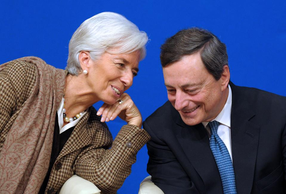 """International Monetary Fund (IMF) Managing Director Christine Lagarde talks with European Central Bank (ECB) president Mario Draghi during the """"Treasury Talks"""" at French Economy and Finances Ministry on November 30, 2012 in Paris. AFP PHOTO ERIC PIERMONT        (Photo credit should read ERIC PIERMONT/AFP/Getty Images)"""
