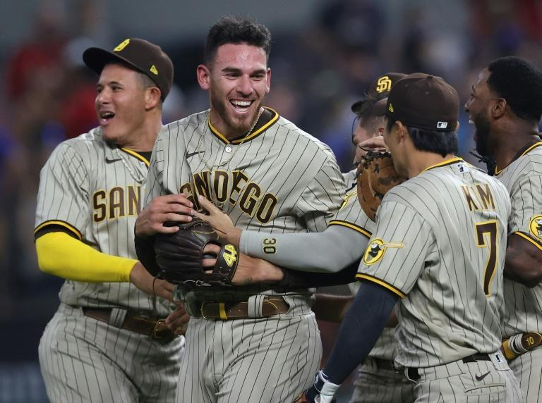 San Diego Padres pitcher Joe Musgrove, centre, is congratulated by his teammates after pitching a no-hitter against the Texas Rangers at Globe Life Field in Arlington, Texas