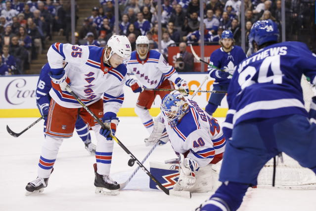 New York Rangers goaltender Alexandar Georgiev (40) makes a save during second-period NHL hockey game action against the Toronto Maple Leafs in Toronto, Saturday, Dec. 28, 2019. (Cole Burston/The Canadian Press via AP)
