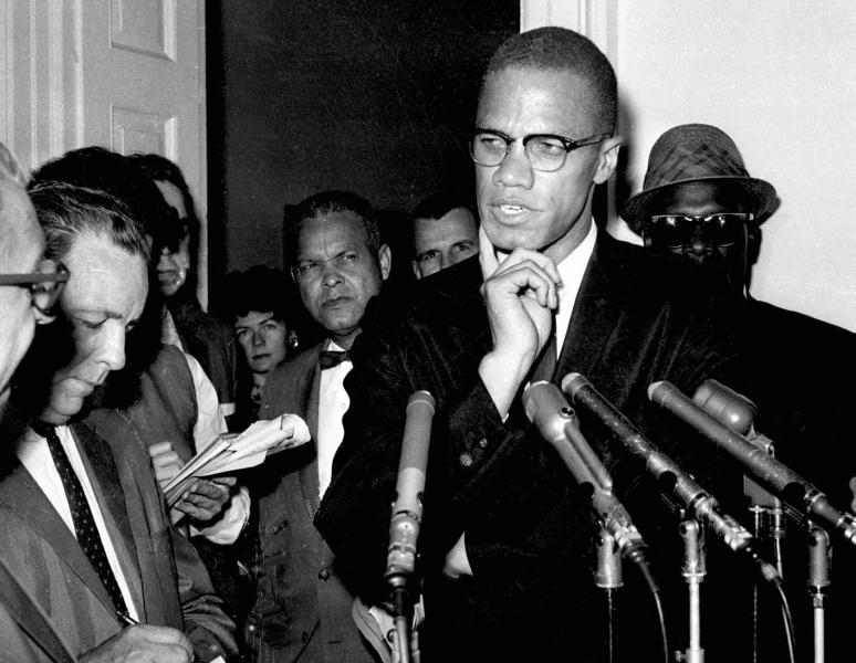 "FILE - In this May 16, 1963, file photo, civil rights leader Malcolm X speaks to reporters in Washington, D.C. ""Who Killed Malcolm X?"" currently streaming on Netflix dives into questions surrounding his assassination and allegations of a botched investigation. (AP Photo/file)"