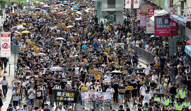 Thousands of peaceful protesters march through the streets of Sheung Shui. Felix Wong