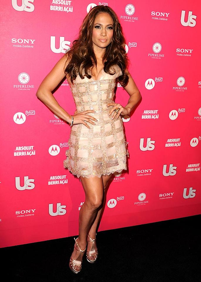 """Jennifer Lopez, who was named <i>Us Weekly</i>'s """"Style Icon of the Decade,"""" hit up the mag's Hot Hollywood Party in a Chantilly lace Georges Chakra Couture dress. She and hubby Marc Anthony reportedly did a little <a href=""""http://www.usmagazine.com/celebritynews/news/jennifer-lopez-marc-anthony-dirty-dance-at-us-weekly-bash-2010234"""" target=""""new"""">dirty dancing</a> at the shindig, which was held at Drai's Hollywood inside the W Hotel. Steve Granitz/<a href=""""http://www.wireimage.com"""" target=""""new"""">WireImage.com</a> - April 22, 2010"""