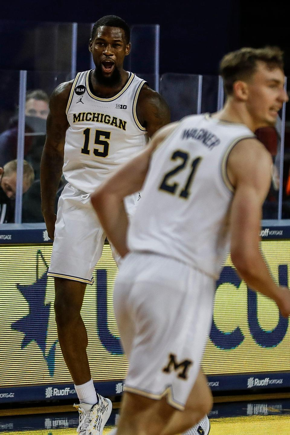Michigan's Chaundee Brown (15) celebrates a 3-point basket against Bowling Green during the season opener at Crisler Center in Ann Arbor, Wednesday, Nov. 25, 2020.