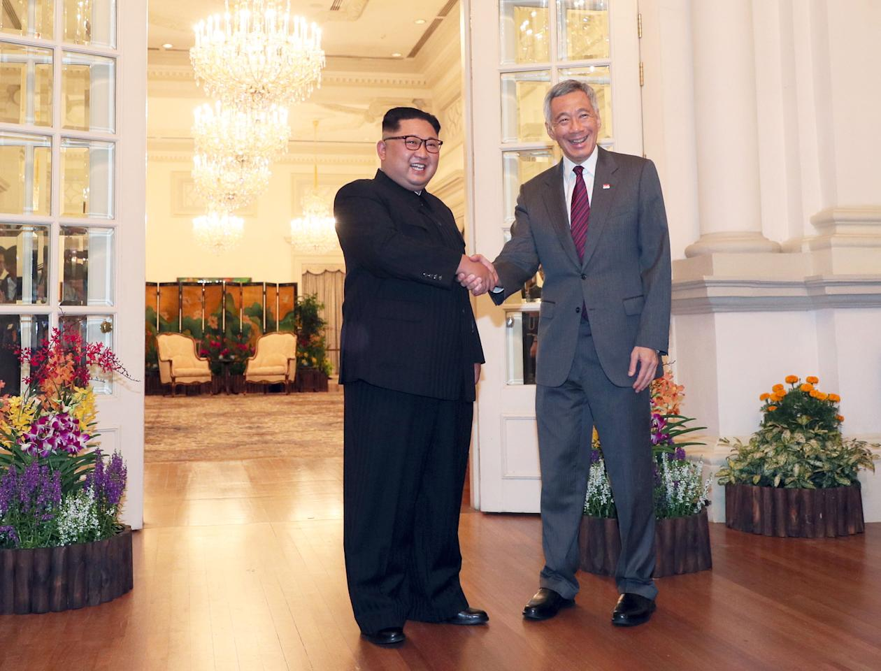<p>North Korean leader Kim Jong Un and Singapore's Prime Minister Lee Hsien Loong shake hands at the Istana. (PHOTO: EFE/EPA) </p>