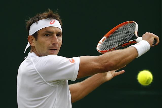 Australia's Marinko Matosevic during a Wimbledon match in southwest London on June 23, 2014 (AFP Photo/Andrew Cowie)
