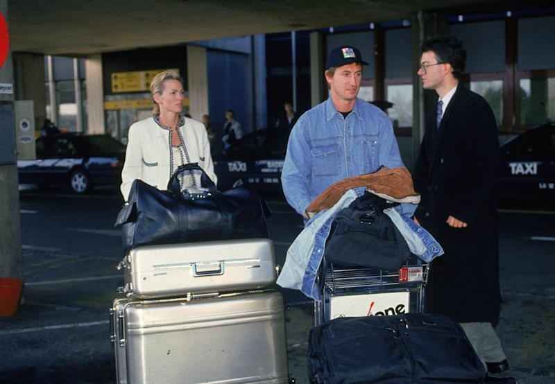 Canadian professional ice hockey player Wayne Gretzky and his wife Janet Jones Gretzky push their luggage on carts at an airport during the Ninety-Nine All Stars Tour, Basel, Switzerland, December, 1994. Gretzky organized the charity event during the players' strike of that year. (Photo by Bruce Bennett/Getty Images)