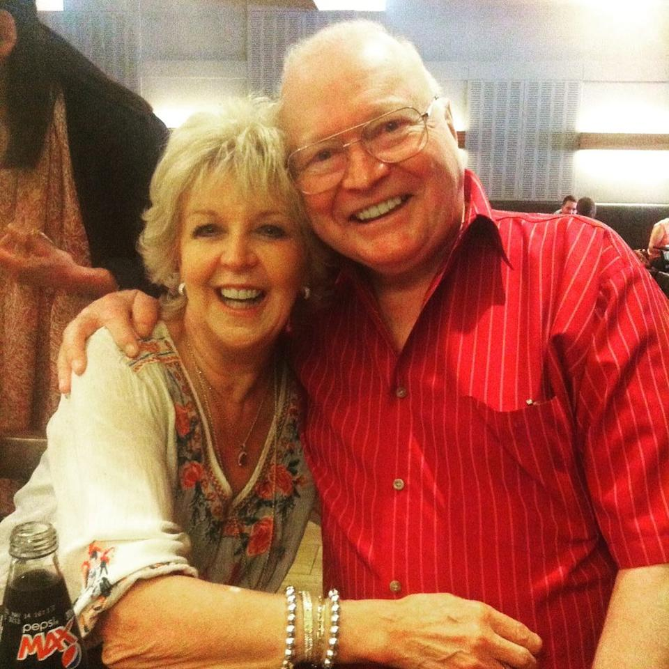 Bert Newton and Patti Newton hugging for a picture