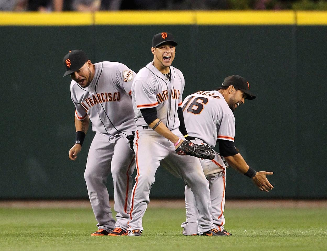SEATTLE, WA - JUNE 15:  L to R: Melky Cabrera #53, Gregor Blanco #7, and Angel Pagan #16 of the San Francisco Giants celebrate after defeating the Seattle Mariners 4-2 at Safeco Field on June 15, 2012 in Seattle, Washington. (Photo by Otto Greule Jr/Getty Images)