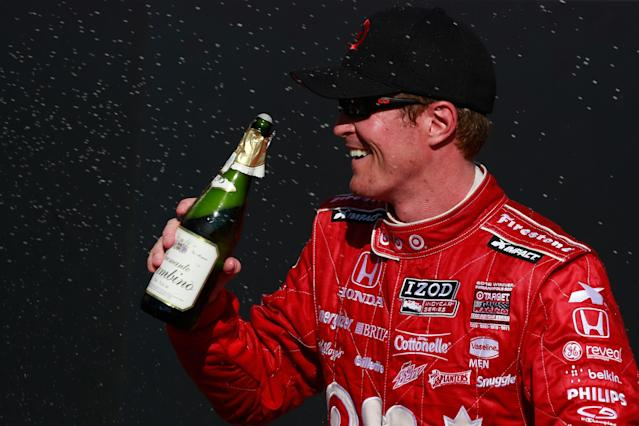 TORONTO, ON - JULY 13: Scott Dixon of New Zealand, driver of the #9 Target Chip Ganassi Racing Honda, celebrates with champagne following his victory in the IZOD INDYCAR Series Honda Indy Toronto Race #1 on July 13, 2013 in Toronto, Canada. (Photo by Chris Trotman/Getty Images)
