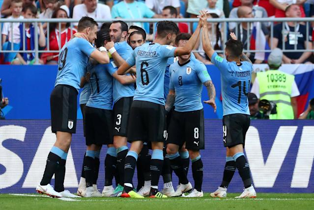 Soccer Football - World Cup - Group A - Uruguay vs Russia - Samara Arena, Samara, Russia - June 25, 2018 Uruguay's Diego Laxalt celebrates scoring their second goal with teammates REUTERS/Pilar Olivares