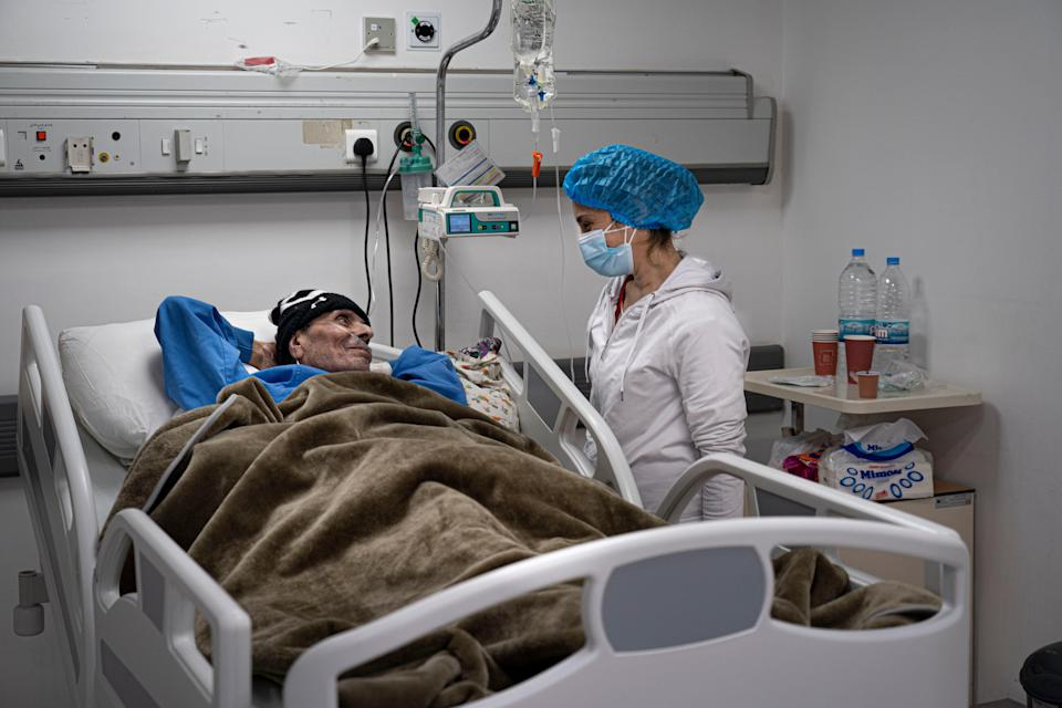 A nurse tends to her sick father in a coronavirus ward at the Rafic Hariri University HospitalBel Trew