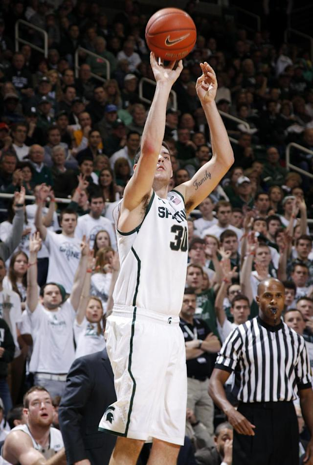 Michigan State's Kenny Kaminski shoots a 3-pointer against Minnesota during the second half of an NCAA college basketball game, Saturday, Jan. 11, 2014, in East Lansing, Mich. Michigan State won 87-75 in overtime. (AP Photo/Al Goldis)