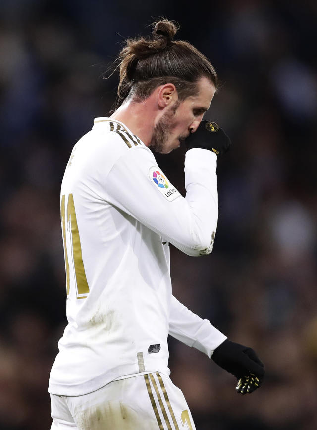 Real Madrid's Gareth Bale leaves the field after the Spanish La Liga soccer match between Real Madrid and Real Sociedad at the Bernabeu stadium in Madrid, Spain, Spain, Saturday, Nov. 23, 2019. Real Madrid won the match 3-1. (AP Photo/Manu Fernandez)