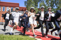 FILE - In this Wednesday June 3, 2020 file photo students run celebrating their high school graduation at Nacka Gymnasium in Stockholm, Sweden. Sweden's relatively low-key approach to coronavirus lockdowns captured the world's attention when the pandemic first hit Europe. (Jessica Gow / TT via AP, File)