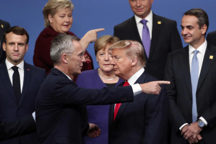 FILE - In this Dec. 4, 2019, file photo, NATO Secretary-General Jens Stoltenberg, front left, speaks with U.S. President Donald Trump, front right, after a group photo at a NATO leaders meeting at The Grove hotel and resort in Watford, Hertfordshire, England. For most of America's allies, Biden is a relief. Trump often sowed chaos, accusing the NATO military alliance of leeching off the United States, insulting the European Union and storming out of a G-7 summit in Canada in 2018. (AP Photo/Francisco Seco, File)