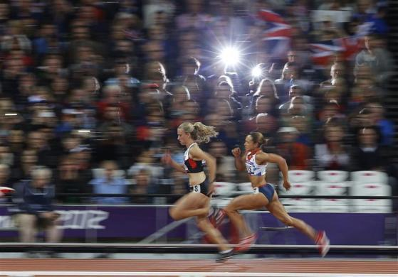 Britain's Jessica Ennis (R) and Canada's Brianne Theisen compete in heat 5 of the women's heptathlon 200m at the London 2012 Olympic Games at the Olympic Stadium August 3, 2012.