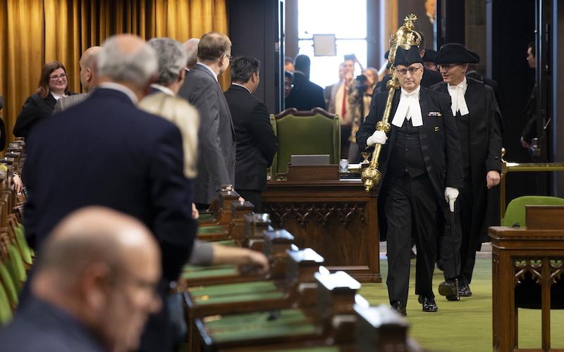 <p>MPs stand as the House of Commons Speaker's Parade enters the new House in the West Block for the first time on Jan. 28. There are modern broadcast facilities in the chamber to capture every moment. Photo from The Canadian Press. </p>