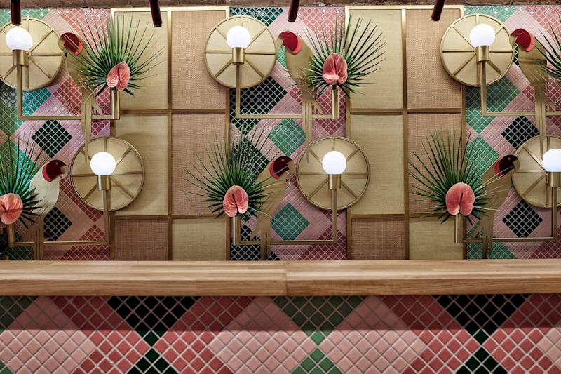 We love how the brass parrots—shockingly enough—blend right into the background, becoming another cohesive pattern at the busy bar.