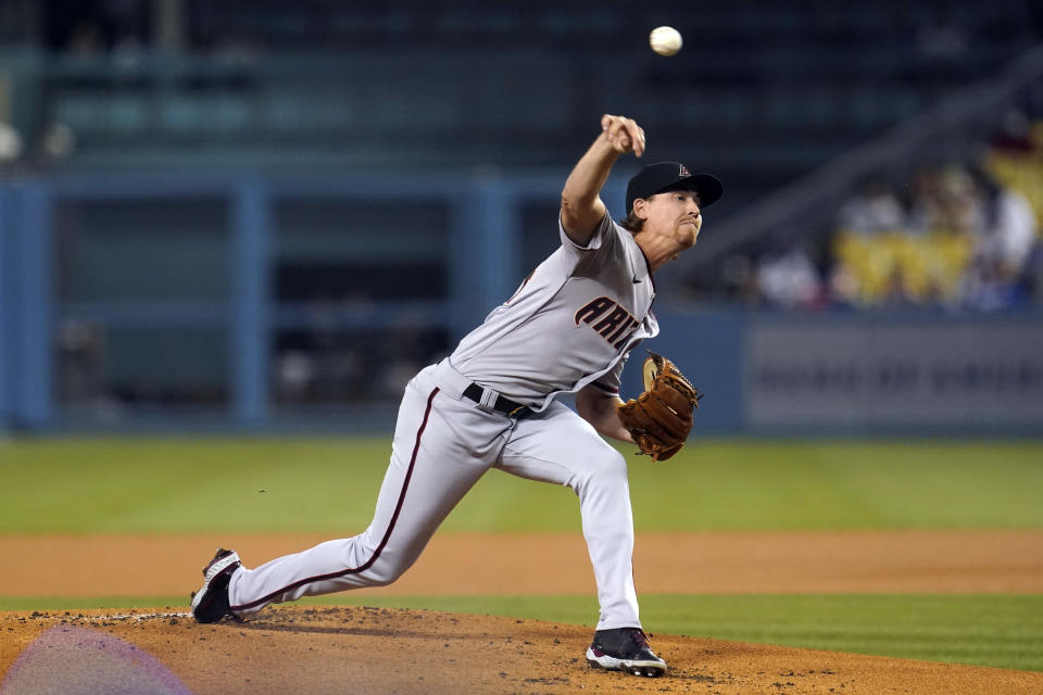 Arizona Diamondbacks starting pitcher Luke Weaver throws to a Los Angeles Dodgers batter during the first inning of a baseball game Tuesday, Sept. 14, 2021, in Los Angeles. (AP Photo/Marcio Jose Sanchez)