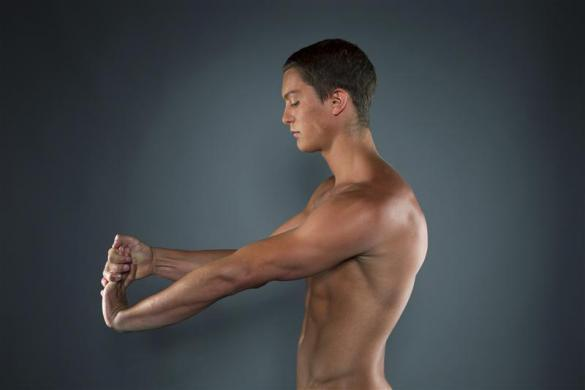 Diver Thomas Finchum stretches while posing for a portrait during the 2012 U.S. Olympic Team Media Summit in Dallas, May 15, 2012.