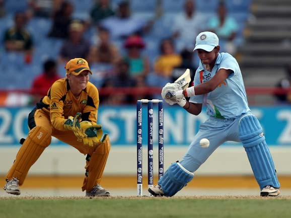 Alyssa Healy of Australia looks on as Harmanpreet Kaur of India hits out during the ICC World Twenty20 semi-final between Australia and India played at the Beausjour Cricket Ground  on May 13, 2010 in Gros Islet, Saint Lucia. (Getty Images)