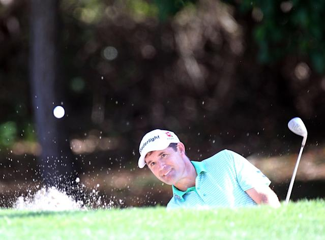 PALM HARBOR, FL - MARCH 15: Padraig Harrington of Ireland plays a shot on the eighth hole during the first round of the Transitions Championship at Innisbrook Resort and Golf Club on March 15, 2012 in Palm Harbor, Florida. (Photo by Sam Greenwood/Getty Images)