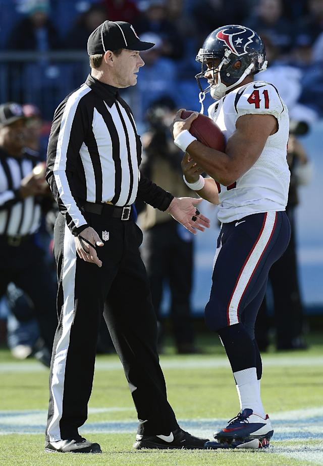 Houston Texans running back Jonathan Grimes (41) tells back judge Lee Dyer, left, that he wants to keep the football after scoring his first career touchdown on a 3-yard run against the Tennessee Titans in the first quarter of an NFL football game Sunday, Dec. 29, 2013, in Nashville, Tenn. (AP Photo/Mark Zaleski)