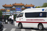 Security guards watch as a vehicle for the epidemic control center pulls up to the entrance into the Tianjin Binhai No. 1 Hotel where U.S. and Chinese officials are expected to hold talks in Tianjin municipality in China Monday, July 26, 2021. America's No. 2 diplomat has arrived in China to discuss the fraught relationship between the two countries on Monday with two top Foreign Ministry officials. (AP Photo/Ng Han Guan)