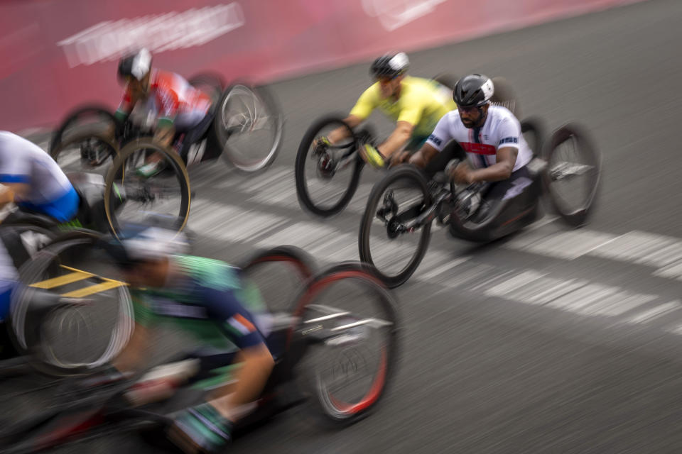 Freddie De Los Santos competes in the Men's H5 Road Race at the Fuji International Speedway in the Tokyo 2020 Paralympics, Wednesday, Sept. 1, 2021, in Tokyo, Japan. (AP Photo/Emilio Morenatti)