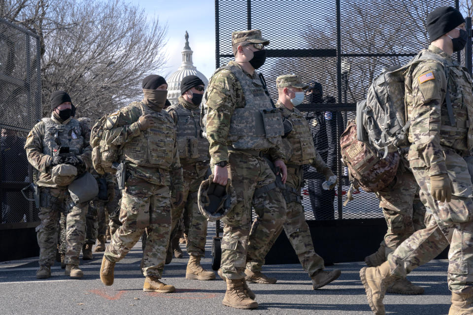 With the U.S. Capitol in the background, members of the National Guard change shifts as they exit through anti-scaling security fencing on Saturday, Jan. 16, 2021, in Washington as security is increased ahead of the inauguration of President-elect Joe Biden and Vice President-elect Kamala Harris. (AP Photo/Jacquelyn Martin)