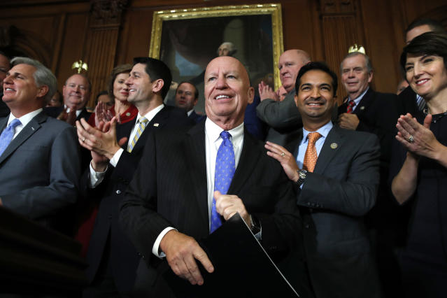 House Ways and Means Chair Rep. Kevin Brady, R-Texas, center, is welcomed by House Republicans including from left, House Majority Leader Kevin McCarthy of Calif., House Speaker Paul Ryan of Wis., Rep. Carlos Curbelo, R-Fla., and Rep. Cathy McMorris Rodgers, R-Wash., as they arrive to speak to the media following a vote on the GOP tax bill, Thursday, Nov. 16, 2017, on Capitol Hill in Washington. (AP Photo/Jacquelyn Martin)