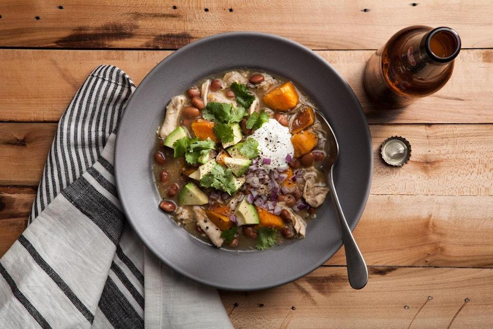 """Made with chicken, sweet potatoes, tomatillo salsa, and pinto beans, this easy chili is a cross between chile verde and white chicken chili. <a href=""""https://www.epicurious.com/recipes/food/views/slow-cooker-green-chicken-chili?mbid=synd_yahoo_rss"""" rel=""""nofollow noopener"""" target=""""_blank"""" data-ylk=""""slk:See recipe."""" class=""""link rapid-noclick-resp"""">See recipe.</a>"""
