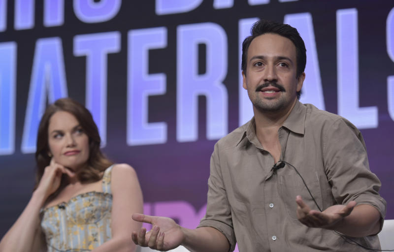 """Lin-Manuel Miranda, right, speaks as Ruth Wilson looks on in HBO's """"His Dark Materials"""" panel at the Television Critics Association Summer Press Tour on Wednesday, July 24, 2019, in Beverly Hills, Calif. (Photo by Richard Shotwell/Invision/AP)"""