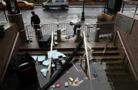 Water floods the Plaza Shops in the wake of Hurricane Sandy, on October 30, 2012 in Manhattan, New York.The storm has claimed at least 16 lives in the United States, and has caused massive flooding across much of the Atlantic seaboard. US President Barack Obama has declared the situation a 'major disaster' for large areas of the US East Coast including New York City. (Photo by Allison Joyce/Getty Images)