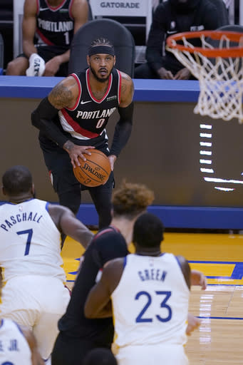Portland Trail Blazers forward Carmelo Anthony (00) looks to shoot a 3-pointer against the Golden State Warriors during the first half of an NBA basketball game in San Francisco, Friday, Jan. 1, 2021. (AP Photo/Tony Avelar)