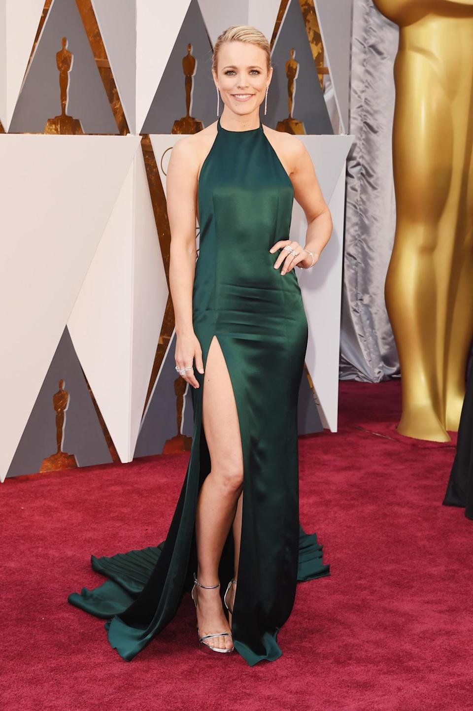 <p>Rachel McAdams has had an epic awards season in the fashion department, from a pretty Prada minidress moment to an amazing Elie Saab gown at the Golden Globes. But she went out with a bang in an emerald green August Getty silk piece with a high neckline and super high leg slit. <i><i>(Photo: Getty Images)</i></i></p>