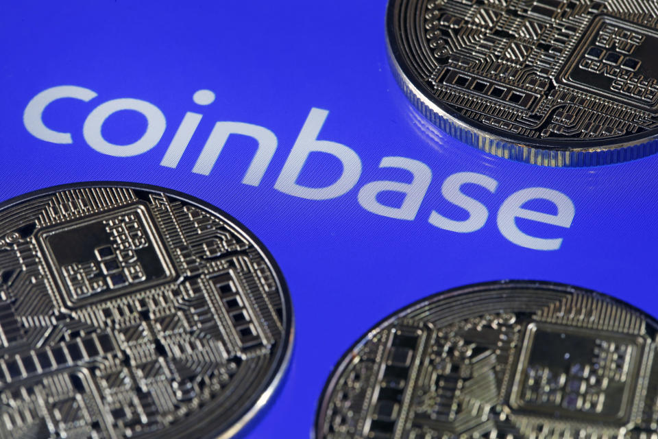 Digital cryptocurrency Bitcoin is displayed in front of the Coinbase cryptocurrency exchange platform logo. (Photo: Getty)