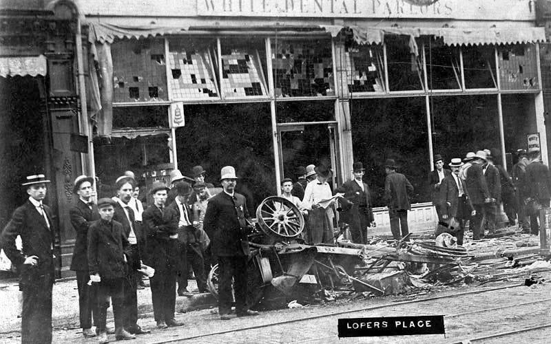 Harry Loper's restaurant at 223 S. Fifth Street in Springfield, Ill., appears demolished and his car destroyed by rioters in 1908.